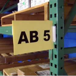Slip-N-Stik Aisle Sign Kit snaps into pallet rack assembly holes - Just snap out to relocate. Whether a warehouse, library or store room, sign posting starts in the aisle and there is no better system than the Slip 'N Stik Aisle Sign Kit.