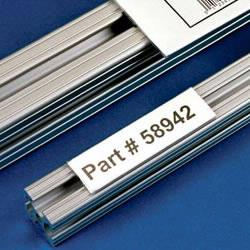 T-Slot label holders are designed to work with T-Slot aluminum framing components. T-Slot label holders identify the contents of framed assemblies. When contents change, just reprint a new insertable paper label. Material Flow sells label holders for less!